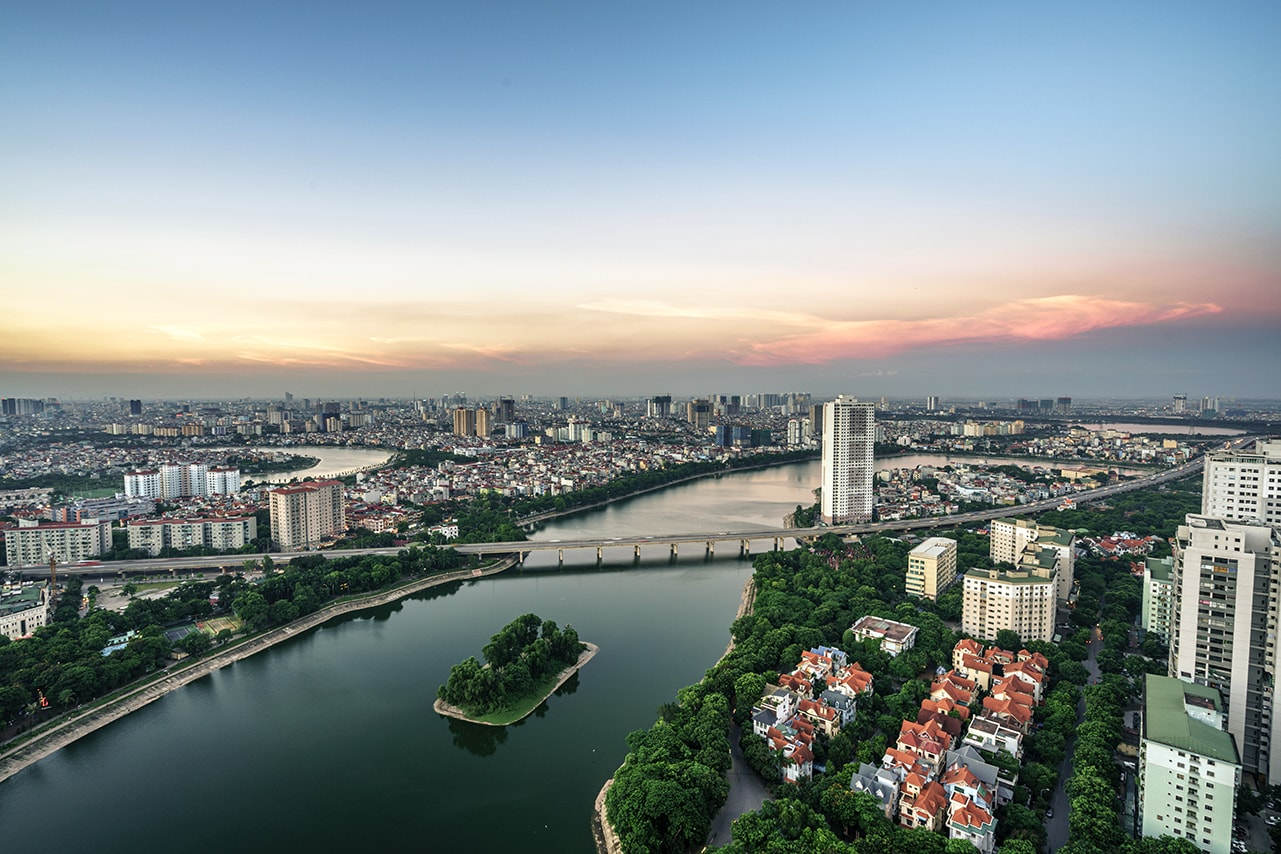 Aerial skyline view of Hanoi cityscape at twilight. Linh Dam peninsula, Hoang Mai district, Hanoi, Vietnam